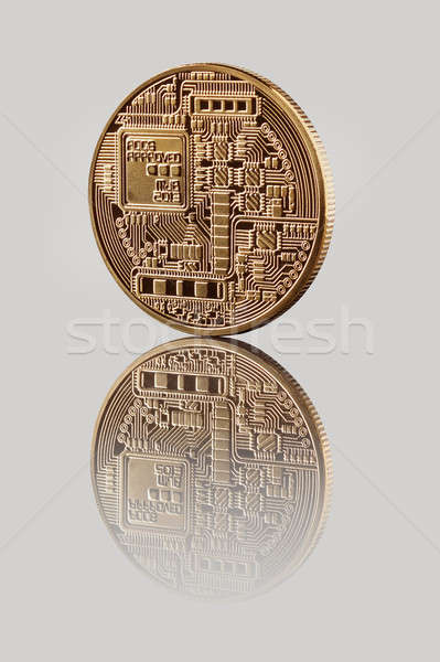 Gold Bitcoin Coin on a gray background Stock photo © artjazz