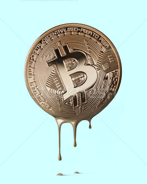 physical bitcoin melting on a blue background Stock photo © artjazz