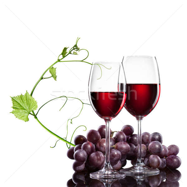 Stock photo: Red wine in glasses with grape and rod isolated on white