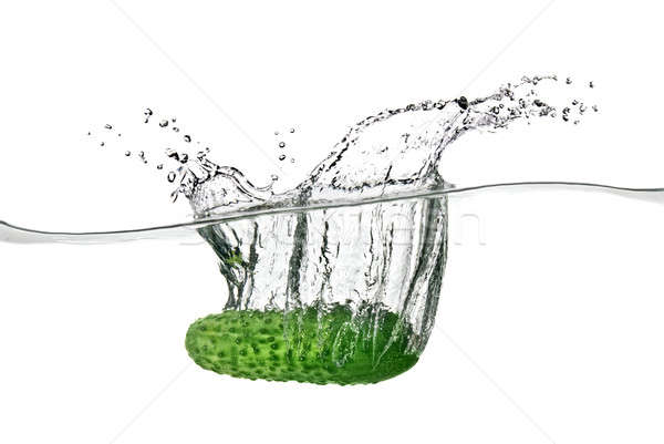 green cucumber dropped into water isolated on white Stock photo © artjazz