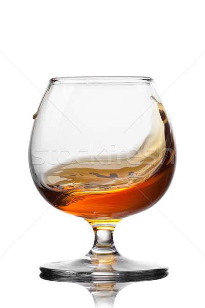 Salpico conhaque vidro isolado branco laranja Foto stock © artjazz