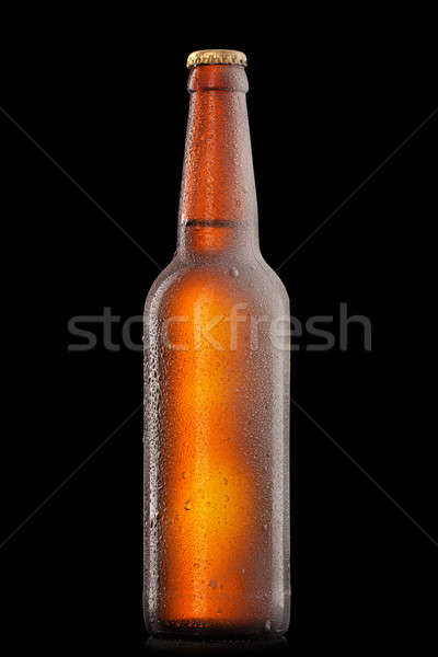 Beer bottle with water drops and frost isolated on black Stock photo © artjazz