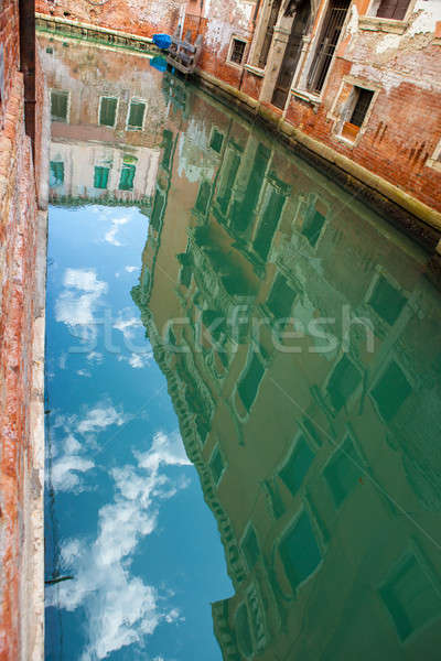 buildings reflected on water canal in Venice Stock photo © artjazz