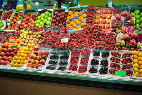 Fruits in baskets on market place Stock photo © artjazz