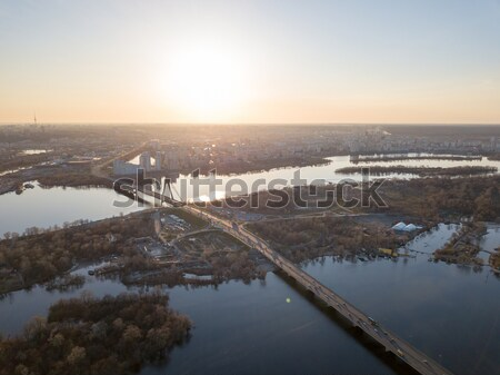 North bridge over the Dnieper River overlooking the Skaimol shopping center and Obolon district on t Stock photo © artjazz