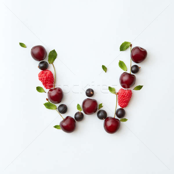 Summer berries pattern of letter W english alphabet from natural ripe berries - black currant, cherr Stock photo © artjazz