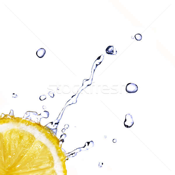 Stock photo: fresh water drops on lemon isolated on white