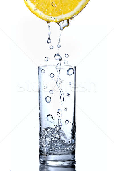 water drops in glass on lemon isolated on white Stock photo © artjazz