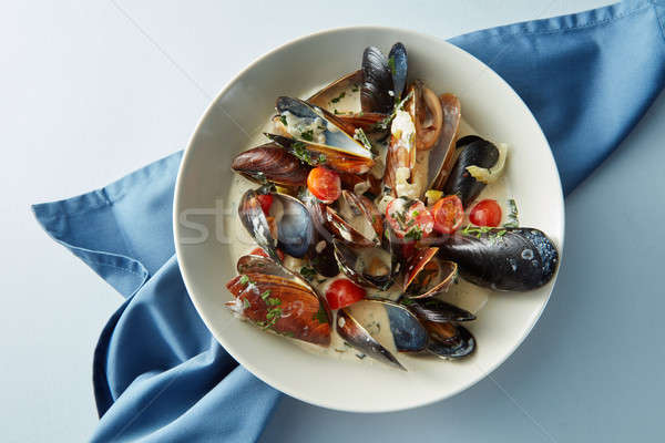 Stock photo: Mussel with white wine sauce on table