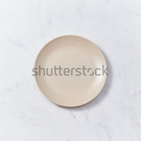 The handmade ceramic dish on a gray marble table. Traditional ceramic handcrafted. Flat lay Stock photo © artjazz