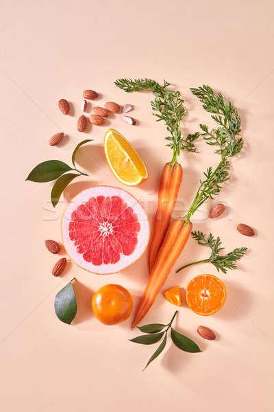 Citrus gyümölcsök narancs zöldségek mandulák természetes Stock fotó © artjazz