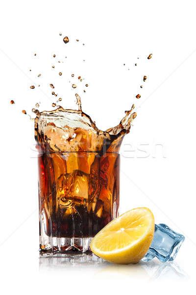Csobbanás kóla üveg citrom jég izolált Stock fotó © artjazz