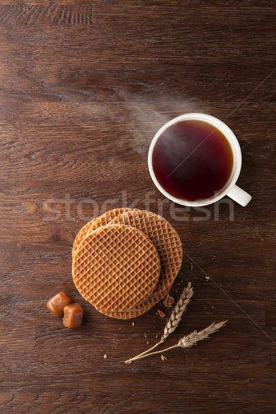 Waffles with caramel and tea on wood Stock photo © artjazz