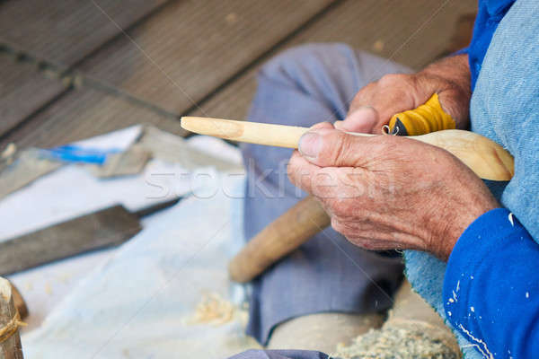 the artisan makes a spoon of wood Stock photo © artjazz