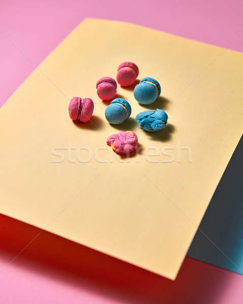 Original composition of colorful macaroons on a yellow paper on paper background Stock photo © artjazz