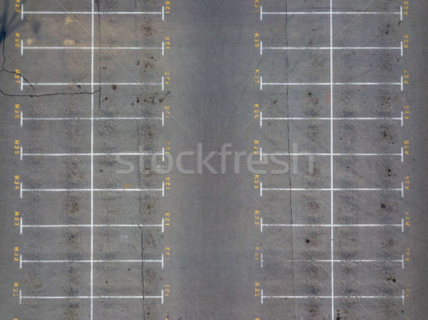 Asphalt floor with parking lot at city center, vacant parking lot. Parking lane painting on floor wi Stock photo © artjazz