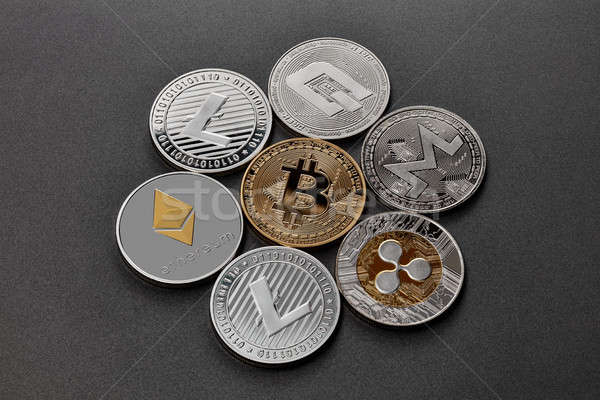 Coins of crypto currency are presented on a dark background. Vir Stock photo © artjazz