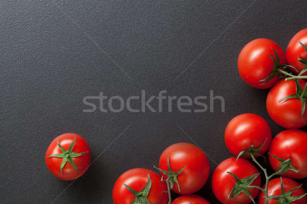 red tomatoes on black. top view Stock photo © artjazz