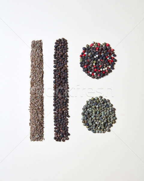 Abstract food geometric pattern with natural organic spices - various kinds of pepper, caraway herb  Stock photo © artjazz