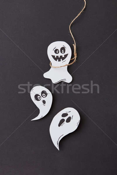 Creative Halloween card with laughing flying scary specter and ghost hanging from a rope handmade fr Stock photo © artjazz