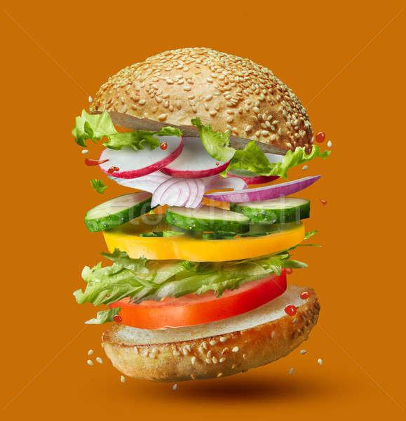 Burger hazırlık malzemeler düşen yer yalıtılmış Stok fotoğraf © artjazz