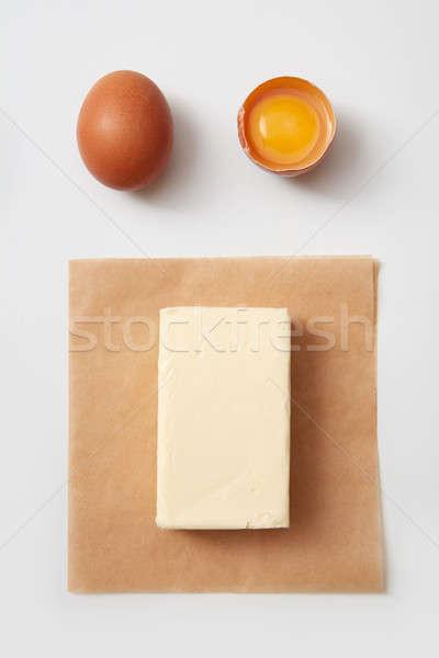 Mantequilla huevos superior vista papel crudo Foto stock © artjazz
