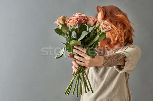 Red-haired girl gives a beige roses cappuccino Stock photo © artjazz