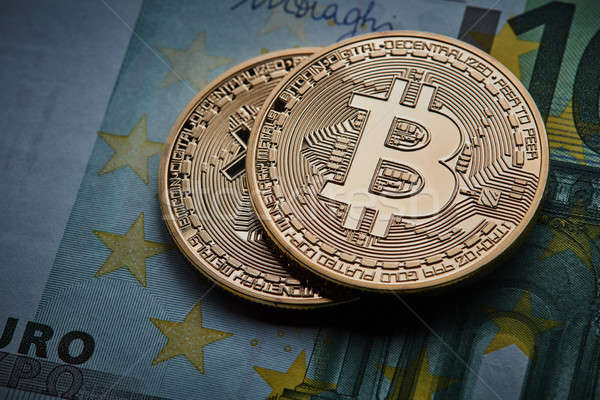 Gold coin Bitcoins, and Euro banknote Cryptocurrency Stock photo © artjazz