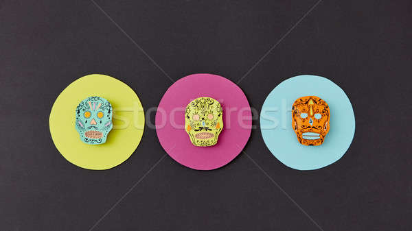 Colorful creative Calaca pattern handcraft from colorful round paper with decorative skulls on a bla Stock photo © artjazz