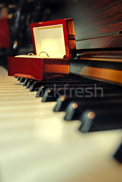 Wedding rings on the piano Stock photo © artjazz