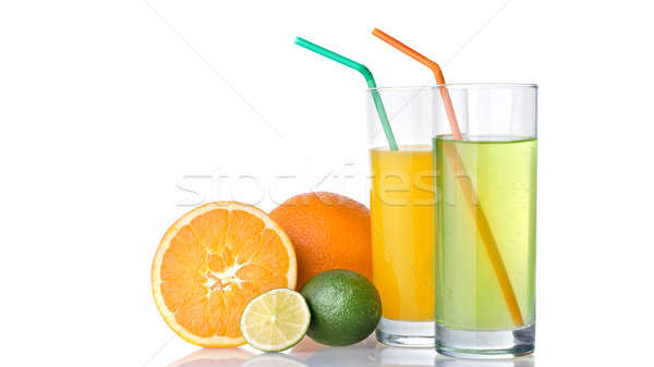 glasses of orange and lime juices with orange and lime fruits Stock photo © artjazz
