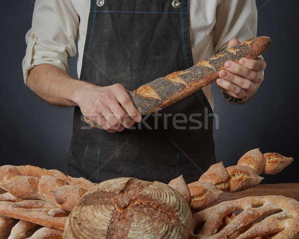 Kezek tart francia kenyér pék pipacs magok Stock fotó © artjazz