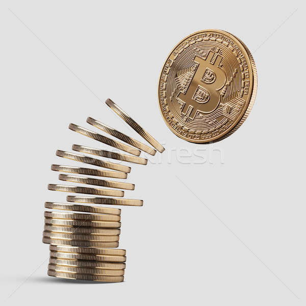 Disintegrate stick coin bitcoin on a gray background. Stock photo © artjazz