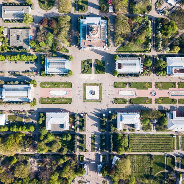 Aerial view shooting from drone of the central symmetrical square of the National Exhibition Center  Stock photo © artjazz