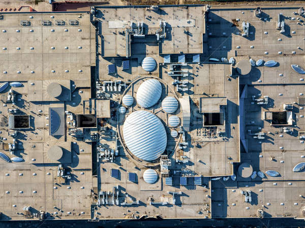 Aerial view from the drones, top view of the roof of the shopping center with ventilation outlets, a Stock photo © artjazz