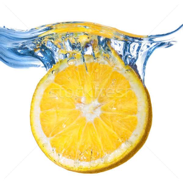Fresh lemon dropped into water with splash isolated on white Stock photo © artjazz