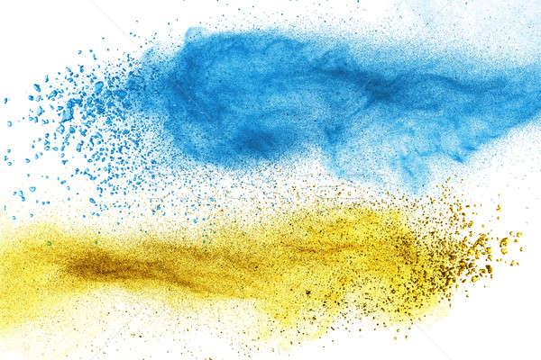 Blue and yellow powder explosion isolated Stock photo © artjazz