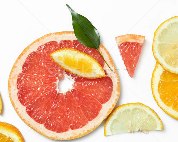 Fresh citrus fruits slices background viewed from above. Stock photo © artjazz