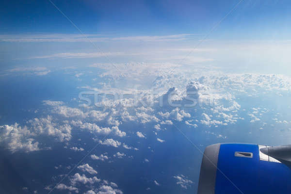 airplane's wing over a blue and cloudy sky Stock photo © artjazz