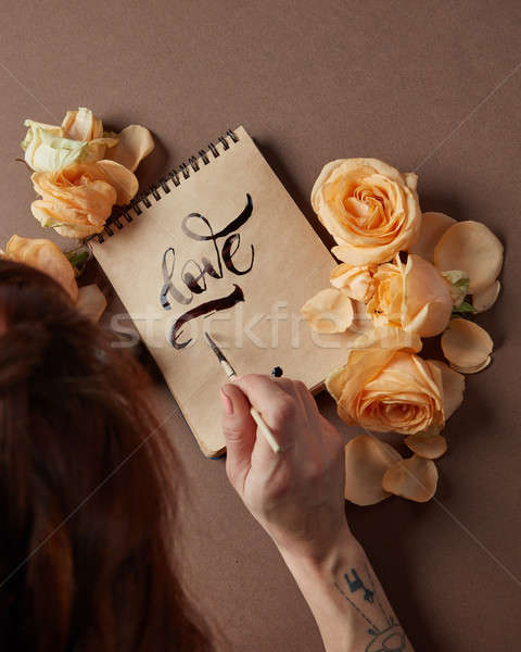 Love letter with roses Stock photo © artjazz