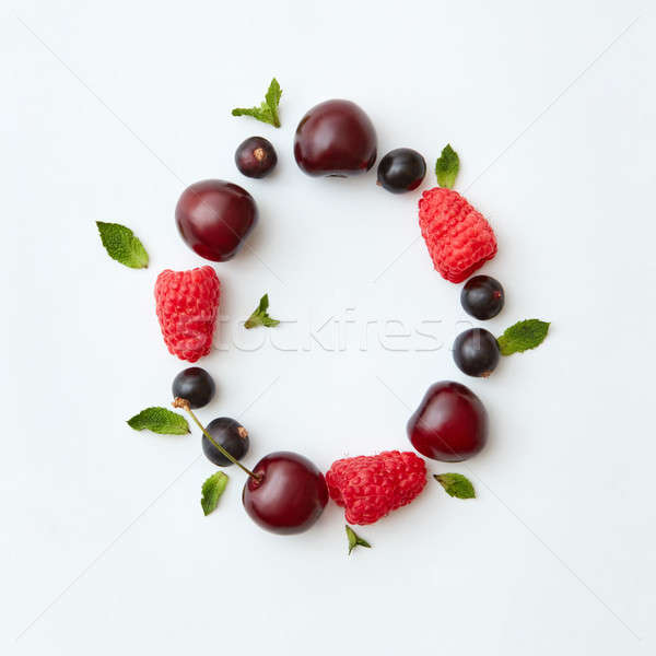 Natural berry pattern of letter O english alphabet from natural ripe berries - black currant, cherri Stock photo © artjazz