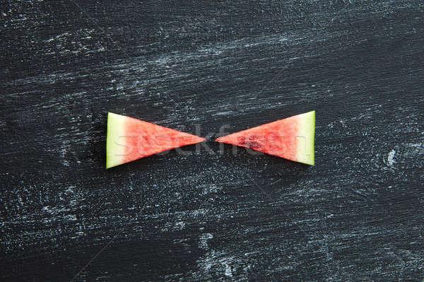 Kettő darabok friss görögdinnye fekete beton Stock fotó © artjazz