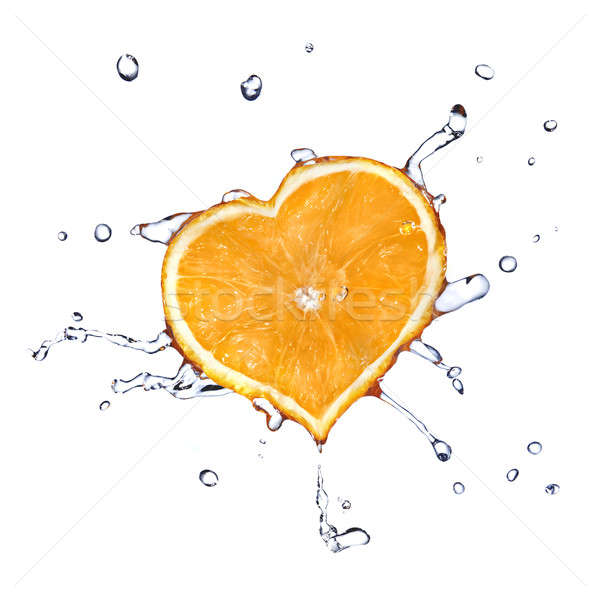 water drops on heart from orange isolated on white Stock photo © artjazz