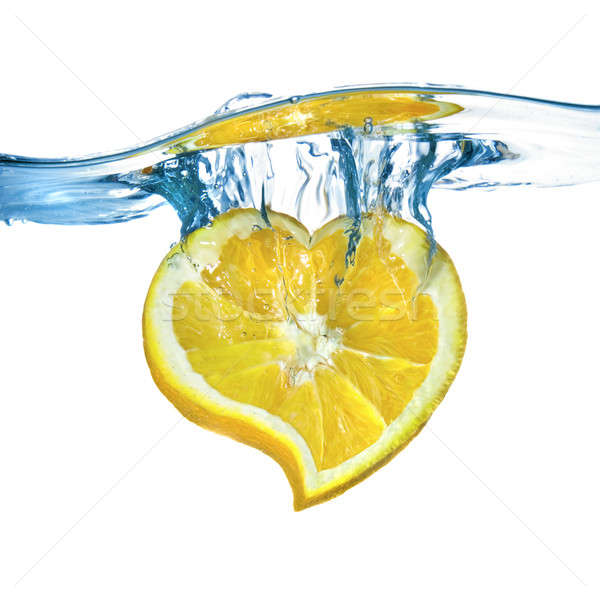 heart from lemon dropped into water isolated on white Stock photo © artjazz
