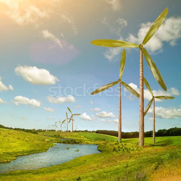 Green energy concept - natural wind generator turbines on summer Stock photo © artjazz