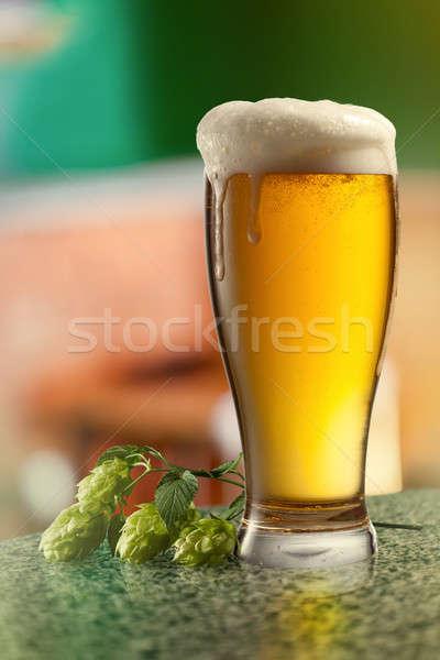 Glassof keg of beer and hops. Stock photo © artjazz