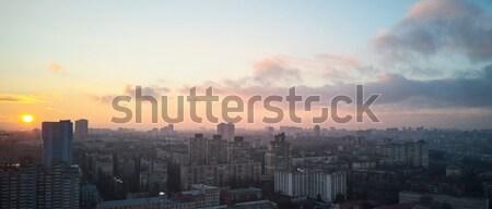 birdseye view of the city at sunrise Stock photo © artjazz