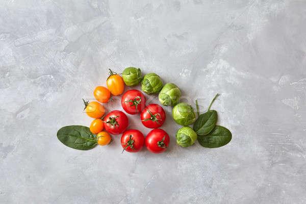 Diverso pomodori spinaci foglie creativo grigio Foto d'archivio © artjazz