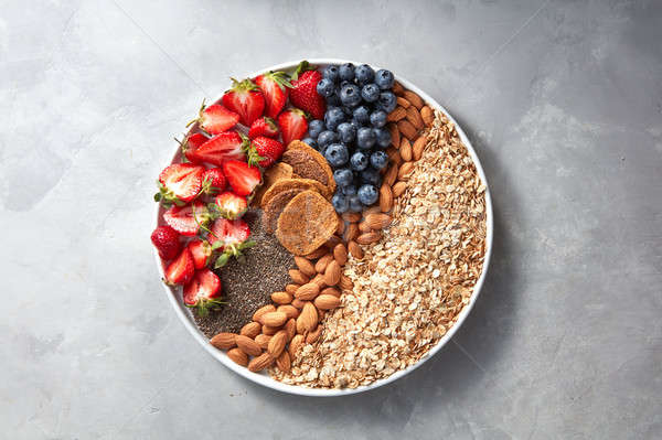 Textúra kása granola bogyók mandula tányér Stock fotó © artjazz