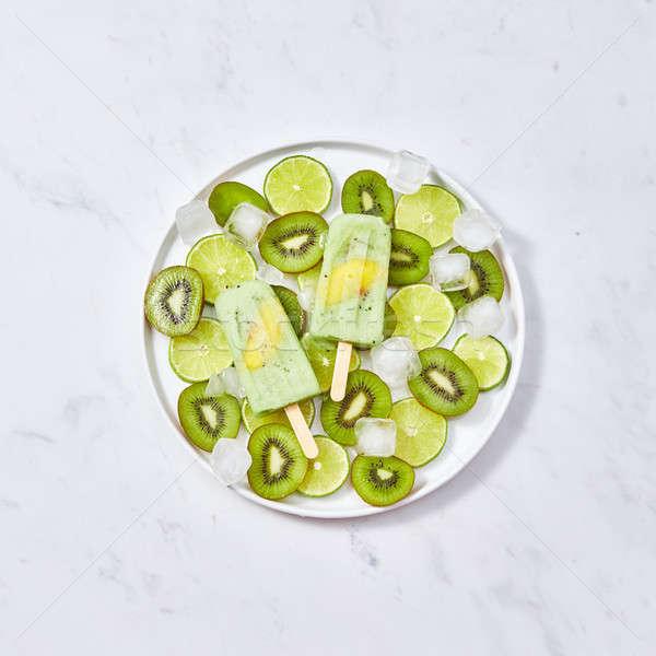 Stock fotó: Fagyott · zöld · darab · barack · tányér · jégkockák